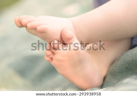 Closeup photo of baby legs, detail - stock photo