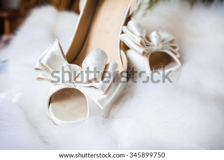 closeup photo of beautiful bride's shoes - stock photo