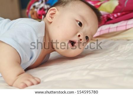 Closeup photo of beautiful cute asian baby's expression - stock photo