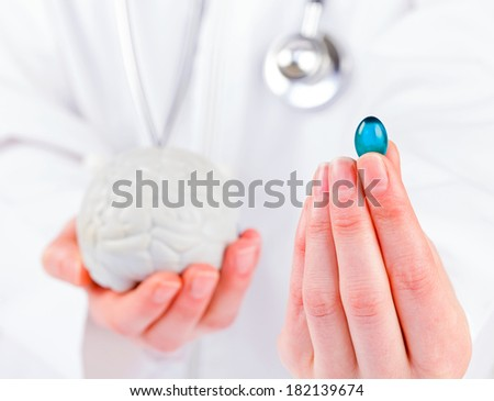 Closeup photo of blue gel capsule in doctor hand - stock photo