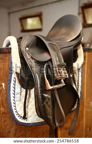 Closeup photo of brown leather saddle.