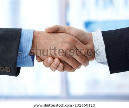 Closeup photo of business handshake, agreement, success, congratulation. - stock photo