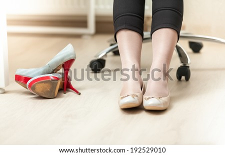 Closeup photo of businesswoman wearing ballet flats - stock photo
