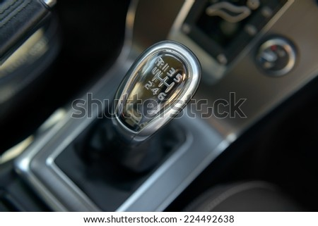 Closeup photo of car gearbox in bright light - stock photo