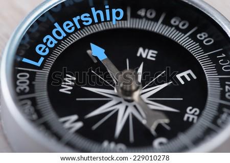 Closeup photo of compass indicating Leadership concept - stock photo
