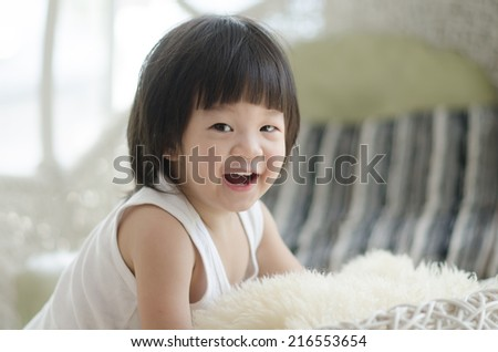 Closeup photo of cute asian baby's expression - stock photo