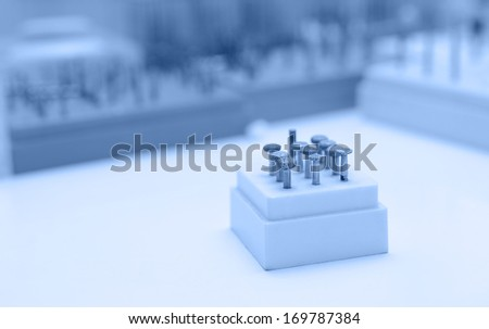 Closeup photo of dentist equipment, blue tone - stock photo