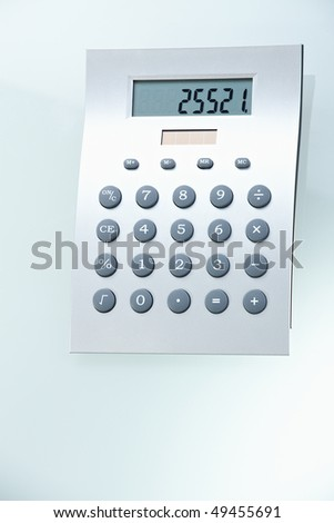 Closeup photo of digital calculator, isolated. - stock photo