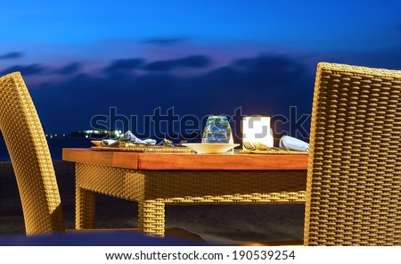Closeup photo of dinner with jaccuzi in twilight  - stock photo