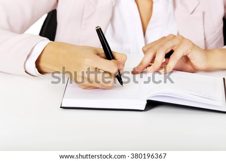 Closeup photo of female hand writing notes