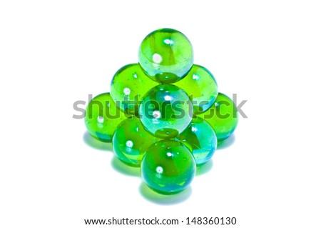 Closeup photo of green marbles forming a pyramid - stock photo