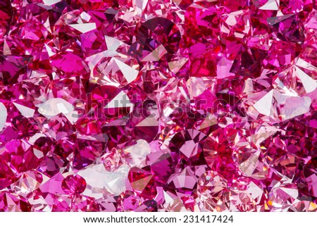 Closeup photo of many small ruby and diamond stones, luxury background - stock photo