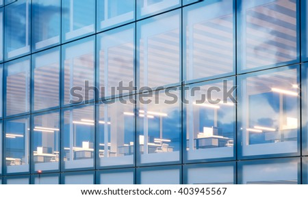 Closeup photo of modern skyscraper interior.Office floor in evening time.Panoramic windows facade background, contemporary business center.Empty workspace. Real horizontal mockup,flares. 3d rendering
