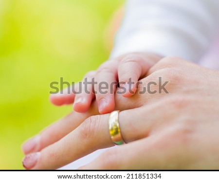 Closeup photo of mother and baby hands - stock photo