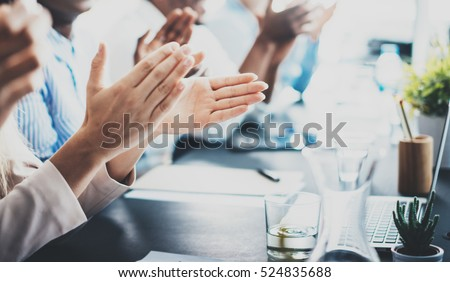 Closeup photo of partners clapping hands after business seminar. Professional education, work meeting, presentation or coaching concept.Horizontal,blurred background
