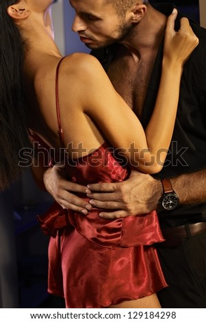 Closeup photo of sexy couple kissing and embracing, making love. - stock photo