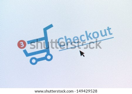 Closeup photo of shopping cart with items and checkout link on the monitor screen - stock photo