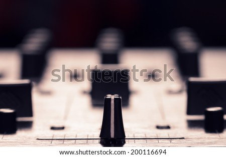 Closeup photo of sound mixer controller with focus on cross fader - stock photo