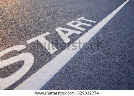 Closeup photo of Start Line on the road.