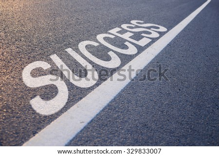 Closeup photo of Success concept on the road.