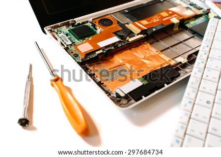 Closeup photo of the disassembled broken computer (laptop). Repair set - stock photo