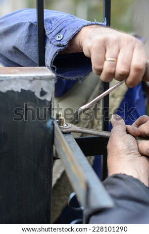 Closeup photo of tho workers  building metal wrench