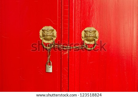 Closeup photo of traditional Chinese locks with red doors - stock photo
