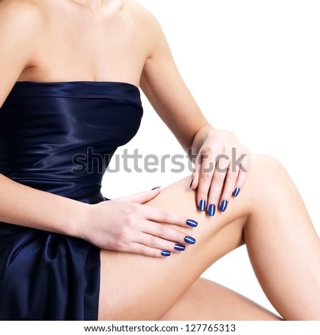 Closeup photo of Women hands with blue nails, isolated on white