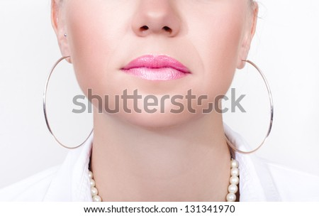 Closeup Photo On The Mouth Of A Girl Wearing Shiny Pink Lipstick