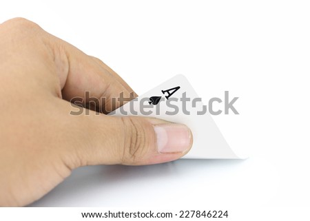 Closeup photos that focuses on the ace card of spades in the hand on white background - stock photo