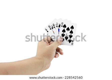Closeup photos that focuses on the royal straight flush of spade in the hand on white background - stock photo