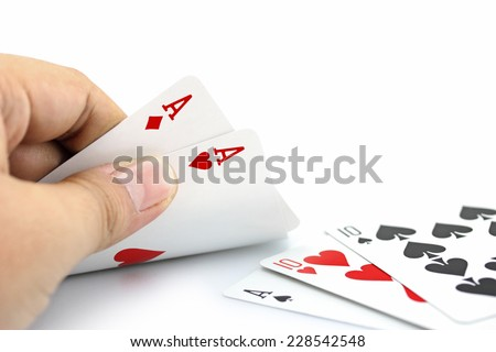 Closeup photos that focuses on two card of ace in hand,in poker game on white background - stock photo