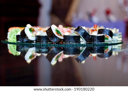 Closeup picture diverse roll sushi, wasabi, sushi roll, fresh Japanese restaurant seafood, tasty asian sea food plate. Traditional oriental gourmet, cuisine kitchen, diet, dish, culture - stock photo