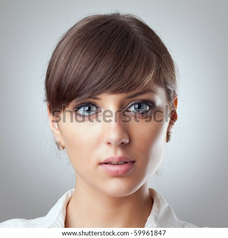 closeup picture of a beautiful business woman's face - stock photo