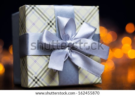 Closeup picture of a beautiful present package over a light background