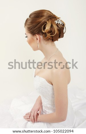 Closeup picture of a bridal hairstyle on white background - stock photo