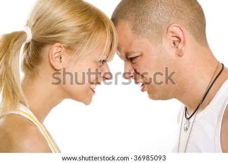 closeup picture of a fighting couple against white