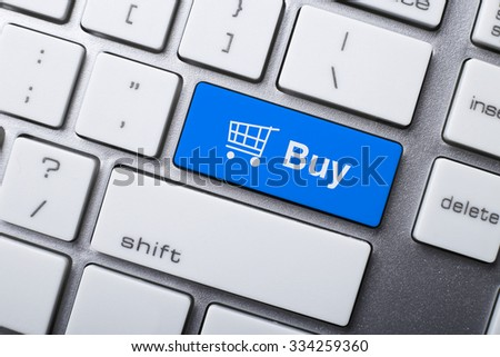 Closeup picture of Buy button of a modern keyboard. - stock photo