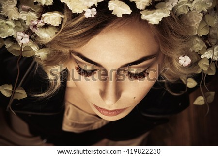 Closeup picture of gorgeous woman with fantasy makeup closed her eyes