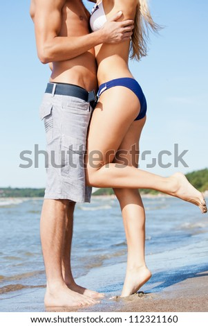 closeup picture of kissing man and woman - stock photo