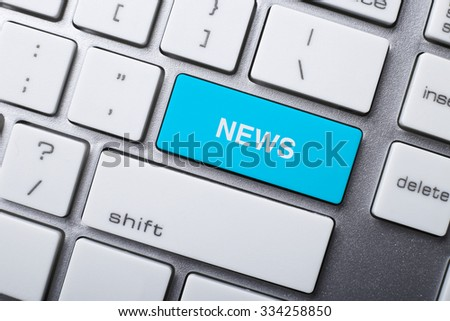 Closeup picture of News button of a modern keyboard. - stock photo