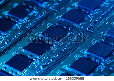 Closeup picture of some computer parts in blue light - stock photo