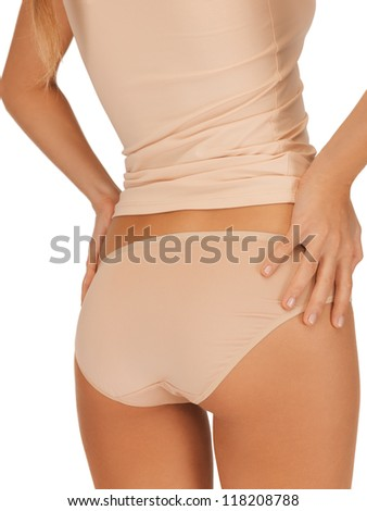 closeup picture of woman in beige cotton undrewear showing slimming concept