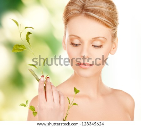 closeup picture of woman with green sprout. - stock photo