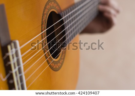 Closeup picture with musician playing guitar