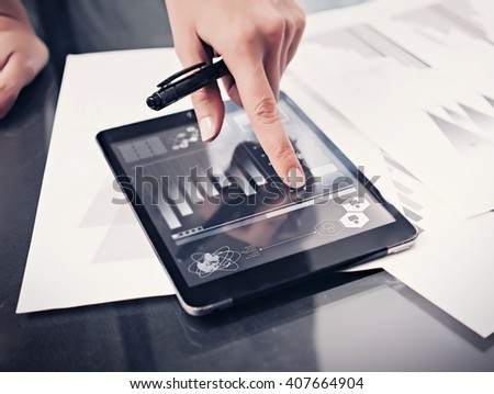 Closeup picture woman working market reports modern tablet and touching screen with worldwide stock exchange icons. Documents for sign on the table. Horizontal. Film effect - stock photo