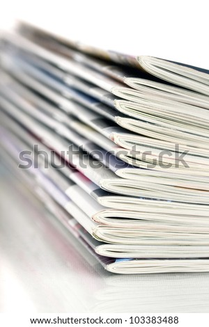 closeup pile of magazines - stock photo