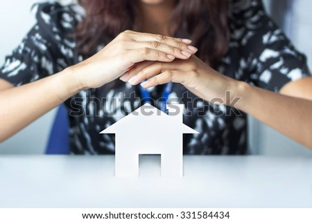 closeup pisture of woman hands holding paper house - stock photo