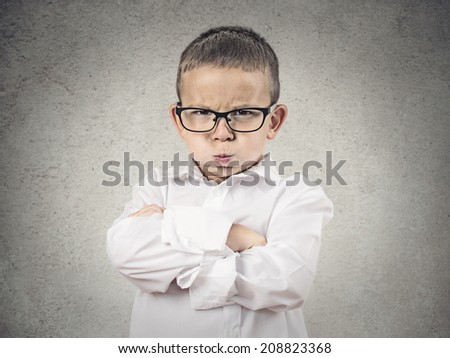 Closeup portrait Angry Boy, Blowing Steam, puffing out his cheeks about to have Nervous atomic breakdown, isolated grey background. Negative human emotion, Facial Expression feeling attitude reaction - stock photo
