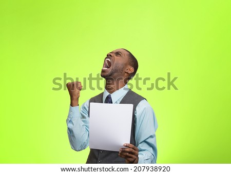 Closeup portrait angry, mad, screaming business man holding paper, document, screaming, looking up isolated green background. Negative emotions, facial expressions, feeling. Financial crisis, bad news - stock photo